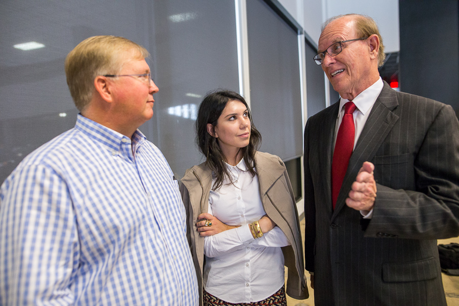 Rackspace Chairman Graham Weston (left) speaks with Deputy Director of Economic Development for Bexar County Jordana Decamps (middle), and Bexar County Judge Nelson Wolff. Photo by Scott Ball.