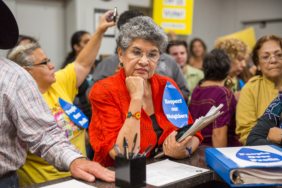 Former Councilmember María Berriozábal waits at the reception desk at City Hall. Photo by Scott Ball.