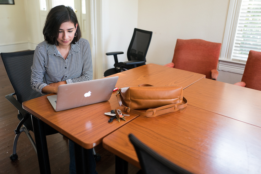 Workery partner and website designer Angelica Arreola works at her computer in one of the buildings. Photo by Scott Ball.