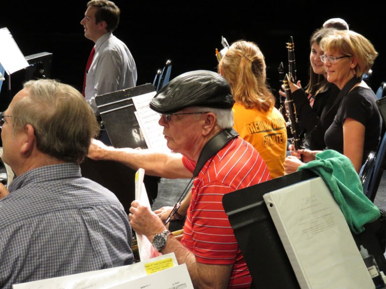Tom Rudwick adjusts his sheet music during rehearsal. Photo by Warren Lieberman.