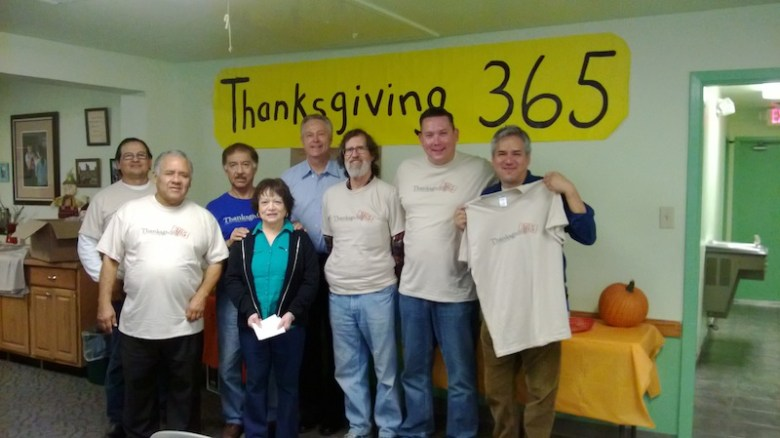 """""""Thanksgiving 365"""" volunteers gather for a group photo, courtesy of Inner City Development."""