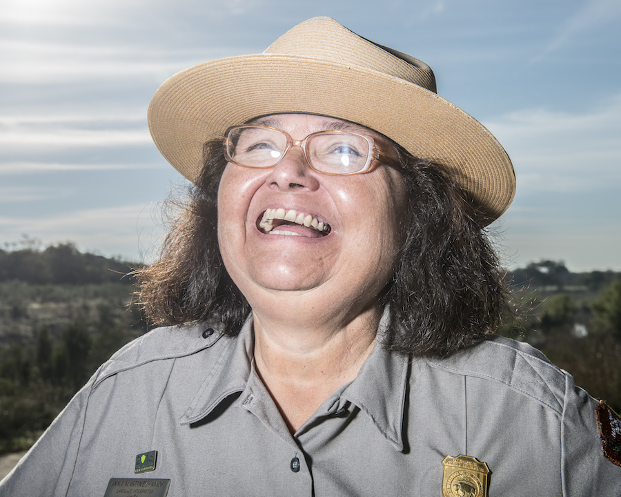 Anna Martinez-Amos, a National Park Service park ranger with community outreach, laughs as a group of birds fly overhead. Photo by Matthew Busch.