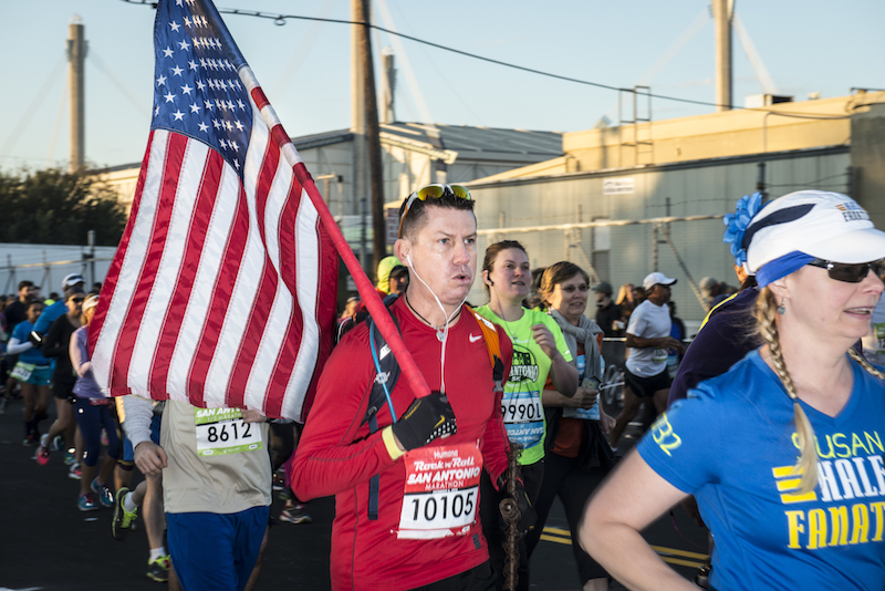 Some runners carried American flags and dressed up in costumes for the race. Photo by Matthew Busch.