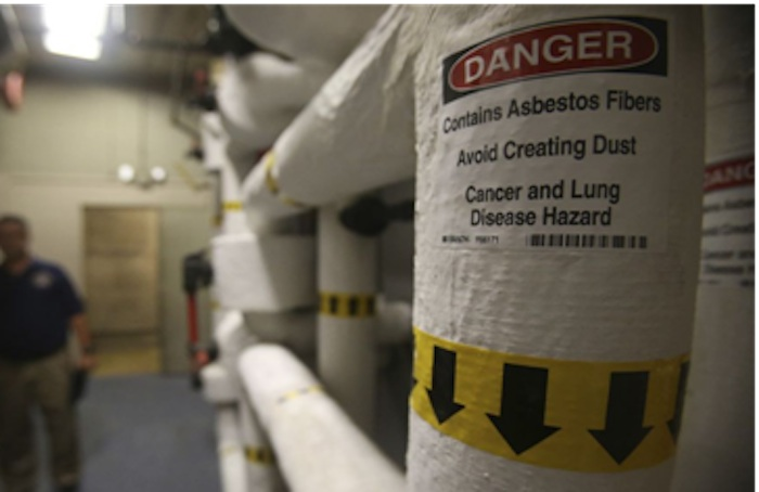 A sign warning passersby of asbestos in the John H. Wood Federal Courthouse. Photo courtesy of the City of San Antonio.
