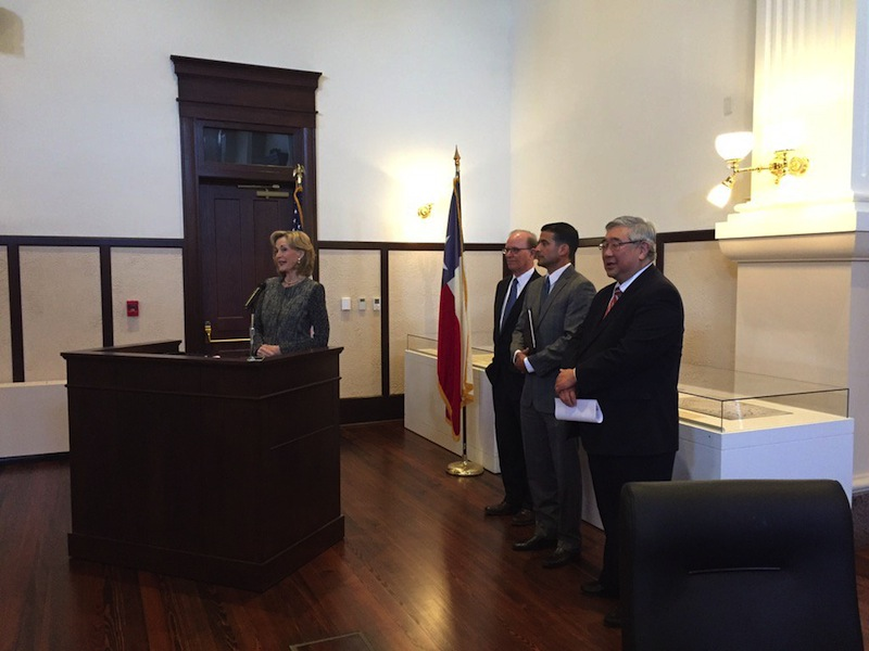 (From left) Hidalgo Foundation President and CEO Tracy Wolff speaks during the brief press announcement with Bexar County Judge Nelson Wolff, Bexar County District Attorney Nico LaHood, and 225th District Court Judge Peter Sakai. Photo courtesy of Bexar County's Twitter.