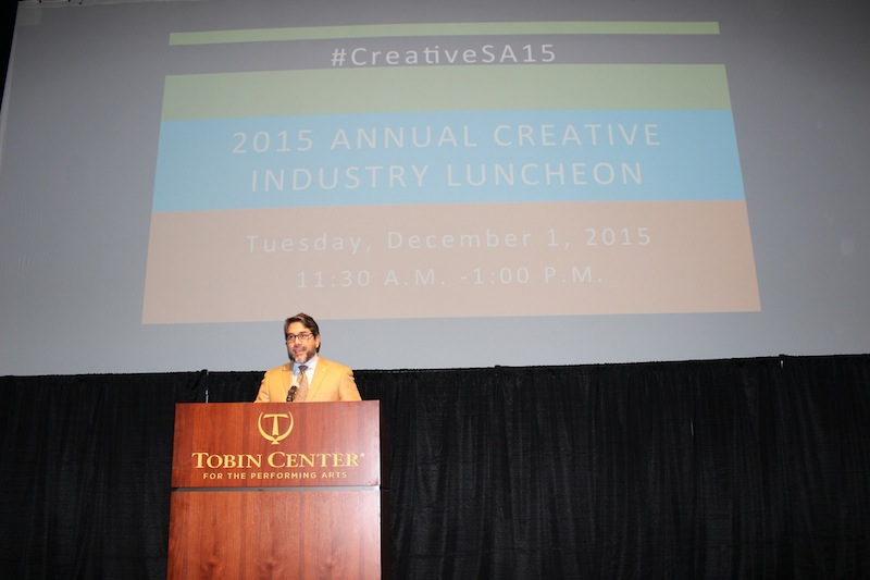 Councilman Roberto Treviño (D1) introduces Candy Chang during the 2015 Annual Creative Industry Luncheon. Photo by Iris Gonzalez.