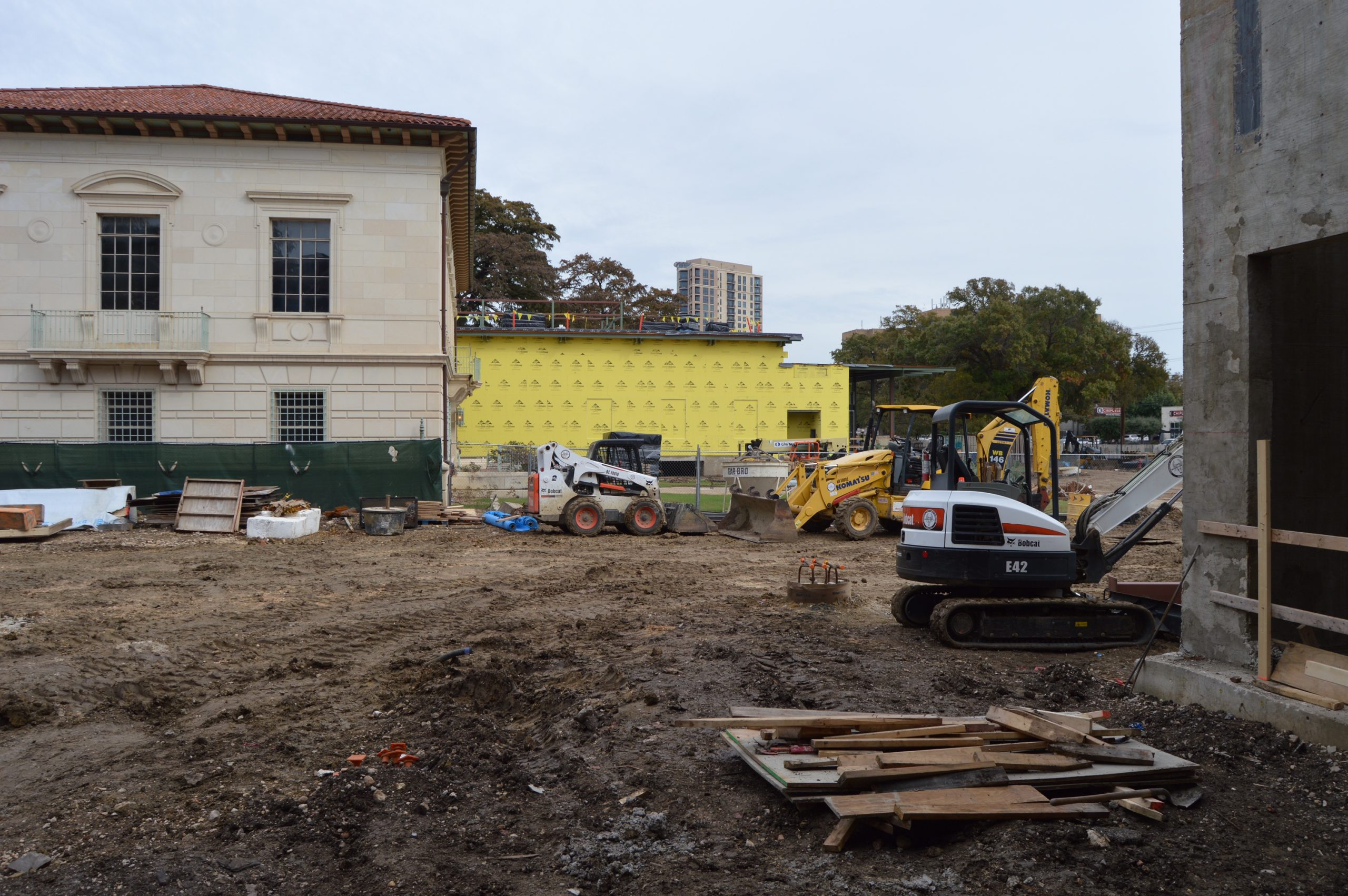 The yellow building will house the Mays Family Center, slated to open in 2016. The center will soon house the Naylor Family Dinosaur Gallery. Photo by Lea Thompson.