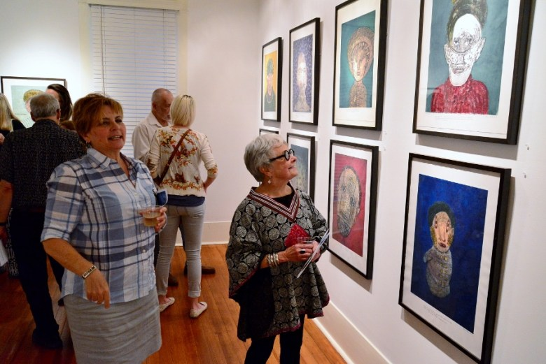 Tami Kegley and Nancy Fullerton discuss Olsen's work at REM Gallery, May 2014. Photo by Page Graham.