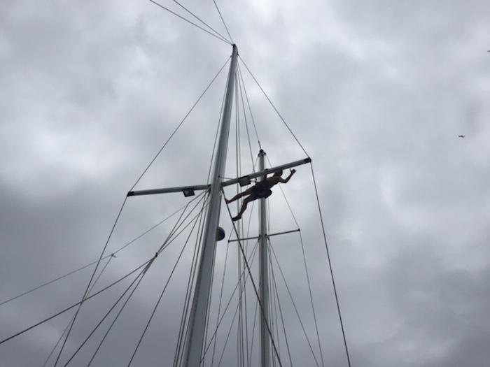 Everett Redus repairs the radar unit on the mast of the Alabama. Photo courtesy of Everett Redus.