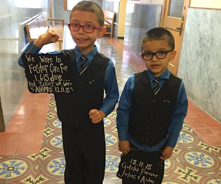 The Garza brothers pose for a photo on the day of their adoption. Photo courtesy of the Children's Shelter.