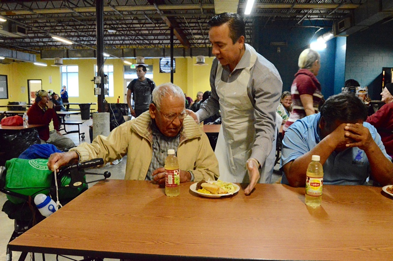Sen. Carlos Uresti serves Christmas dinner to the homeless at Haven for Hope. Photo by Lea Thompson.