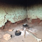 The walls of the kitchen are black towards from smoke. It's fortunate that Thembile has a separate room for cooking. Photo by Casey Miller.