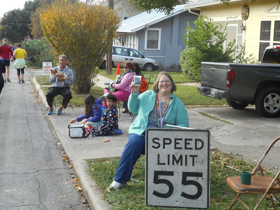 Friends, family and pooches along the marathon route cheer participants. Photo by Don Mathis.