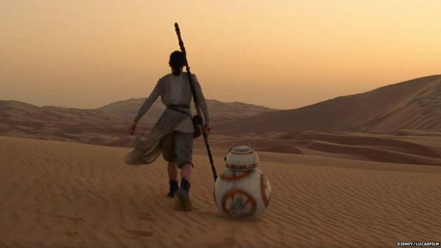 Rey (Daisy Ridley) and BB-8 walk across the Jakku desert. Image courtesy of Disney.