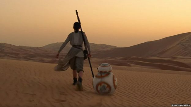 Rey (Daisy Ridley) and BB-8 walk across the Jakku desert. Image courtesy of Disney.