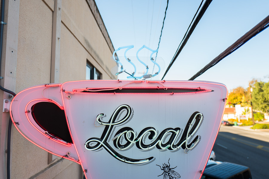 The Local Coffee neon sign that faces Broadway Street. Photo by Scott Ball.