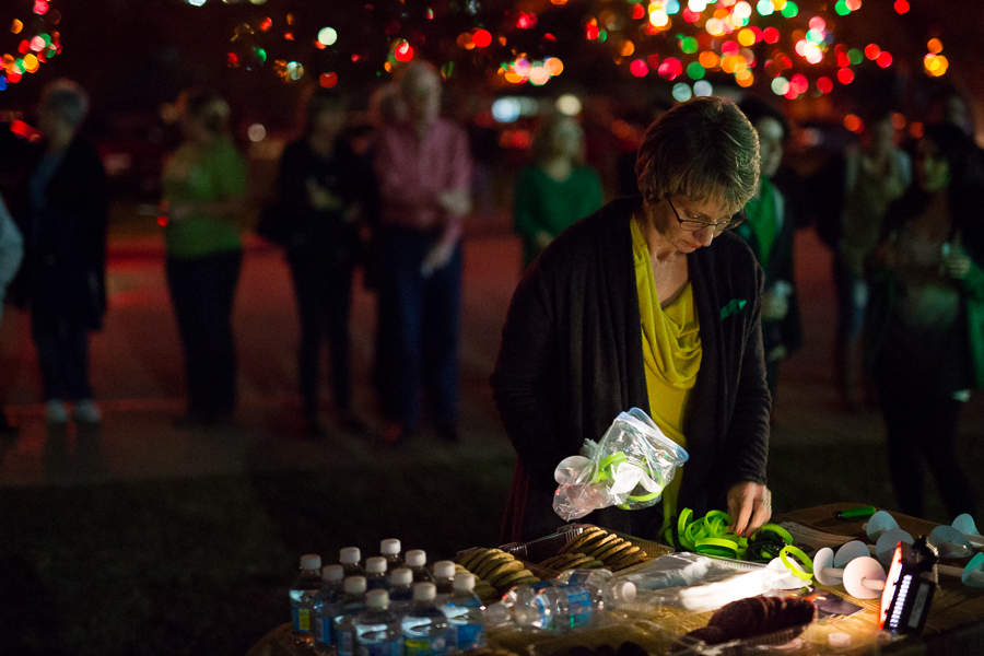 Valerie Redus places wristbands in honor of her son on the table. Photo by Scott Ball.