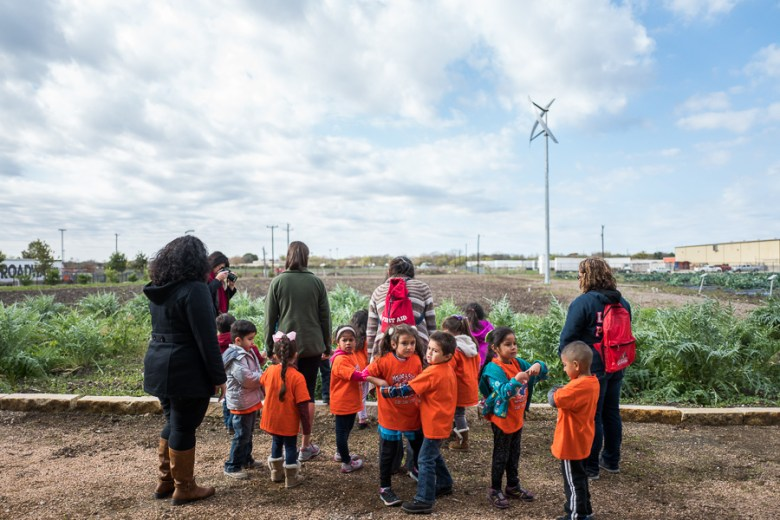 Children and teachers from Pre-K for SA West inspect the farm at the San Antonio Food Bank. Photo by Scott Ball.