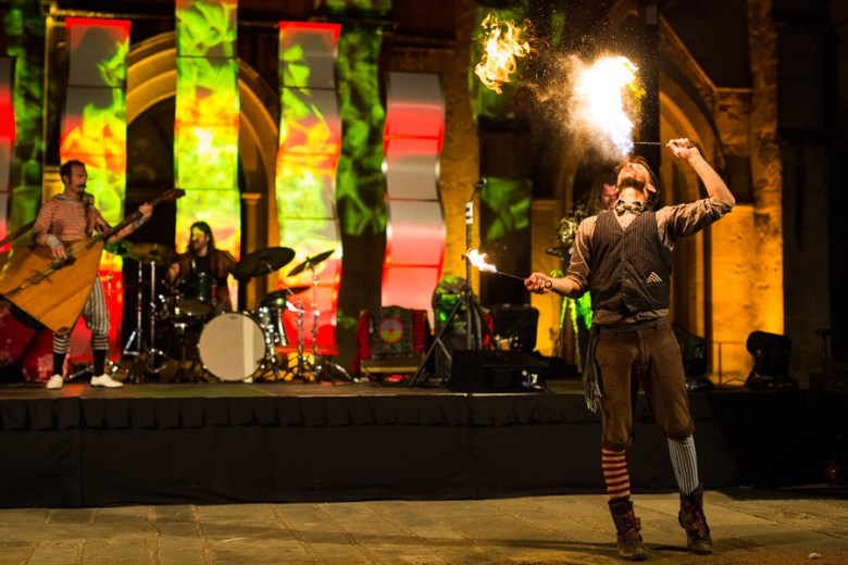 Performer Bobby McDonald blows fire in front of the main stage. Photo by Scott Ball.