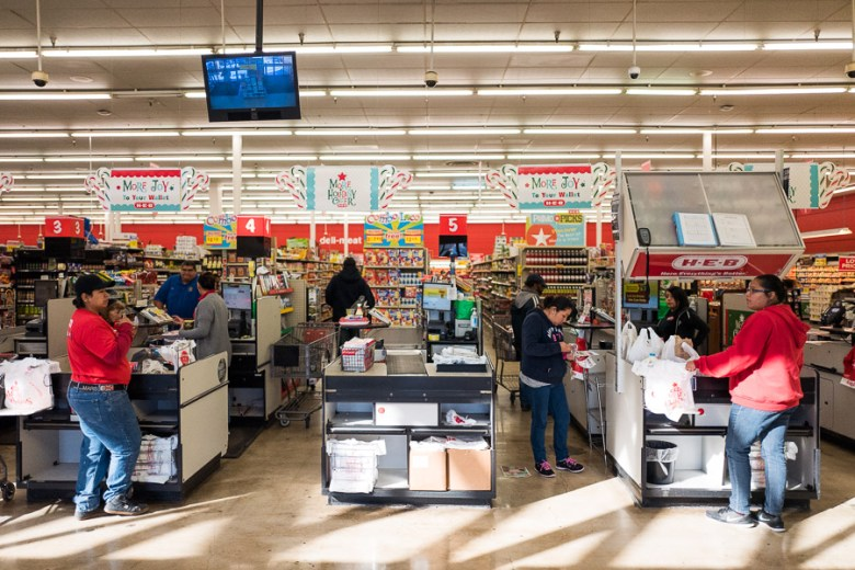 H-E-B employees and customers interact at the checkout lanes. Photo by Scott Ball.