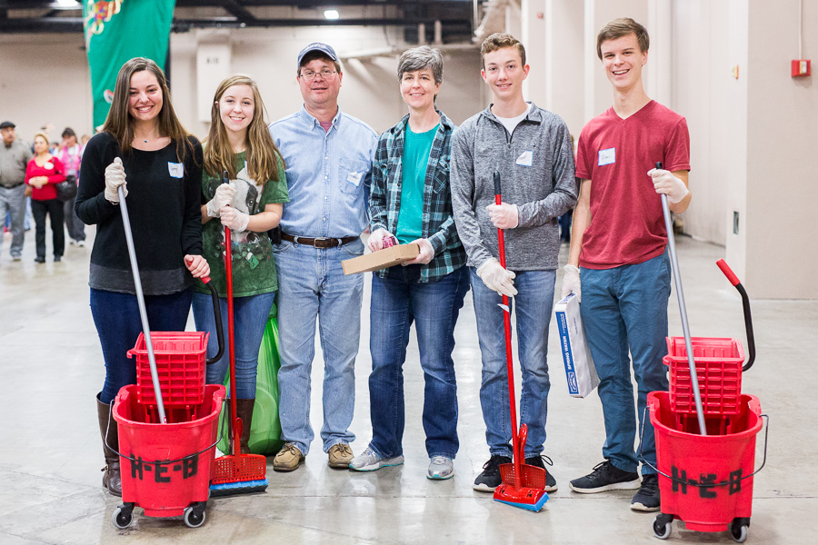Volunteers (left to right) Ginny Scherer, Jamie Reinhard, Gene Reinhard, Darlene Reinhard, Grant, 15, and Issac, 17, pose for a photograph. Photo by Scott Ball.