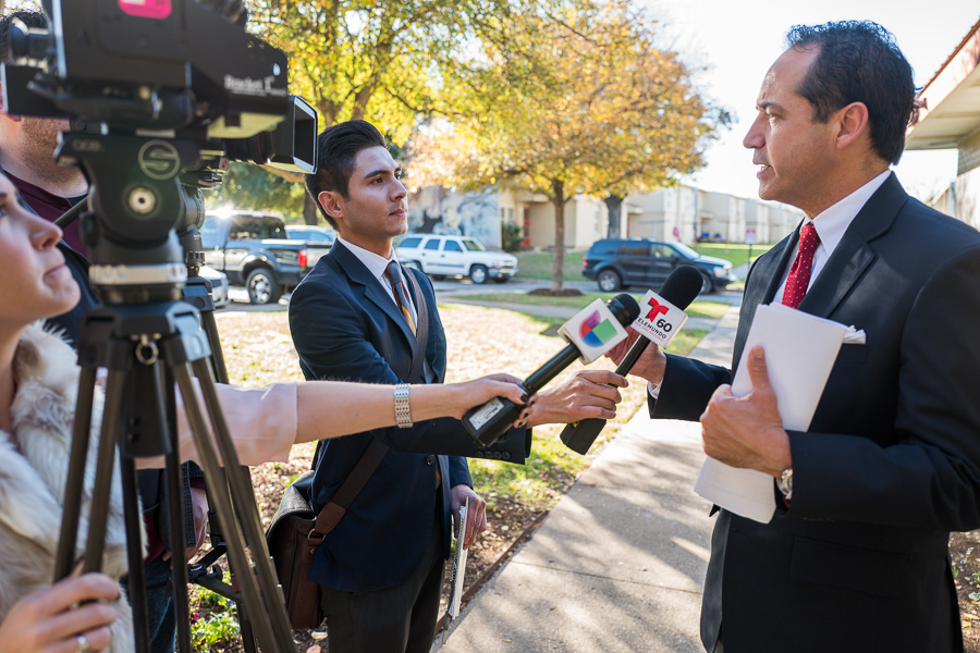 District 26 State Senator José Menéndez responds to questions as he is interviewed for television. Photo by Scott Ball.