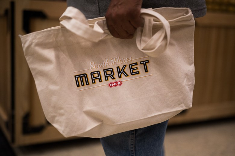 A customer holds his new South Flores Market bag. Photo by Scott Ball.
