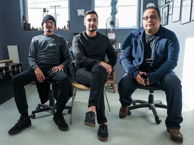 Albert Alvarez, James Medrano, and Alejandro Augustine Padilla sit in a studio in the Lone Star Arts District. Photo by Scott Ball.