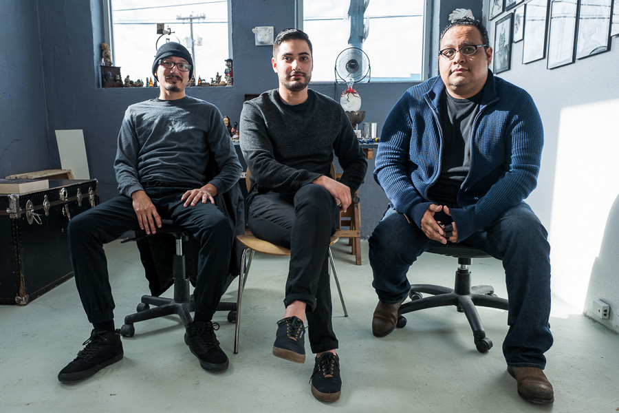 Albert Alvarez, James Medrano, and Alejandro Augustine Padilla sit in a studio in the Lone Star Arts District. Photo by Scott Ball.