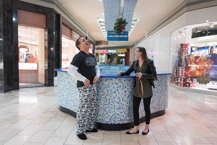 Shops at Rivercenter General Manager Chris Oviatt banters with Sunglass Hut employee Anali Ibarra. Photo by Scott Ball.