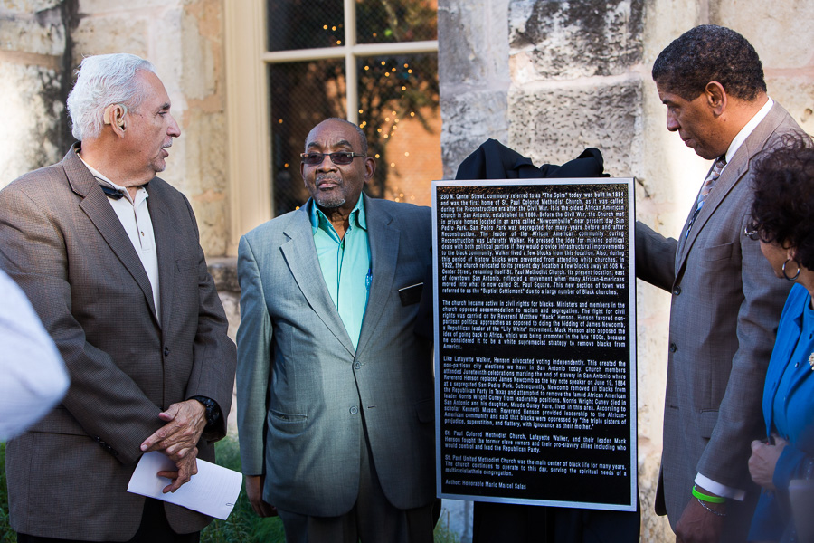 Vice President of the Tax Increment Finance Zone Board 11 Mario Salas (left) looks a the plaque as it is unveiled by Pastor James Amerson (right). Photo by Scott Ball.