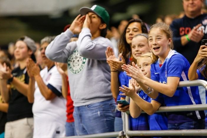 Young girls applaud as players are announced. Photo by Scott Ball.