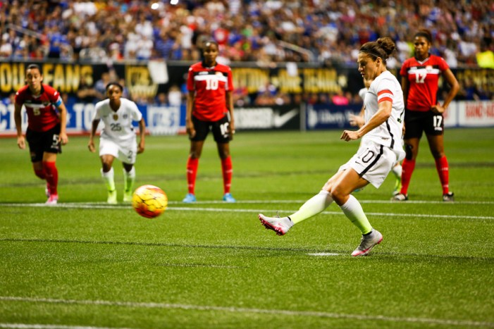 Carli Lloyd scores on a free kick after a Trinidad & Tobago penalty in the box. Photo by Scott Ball.