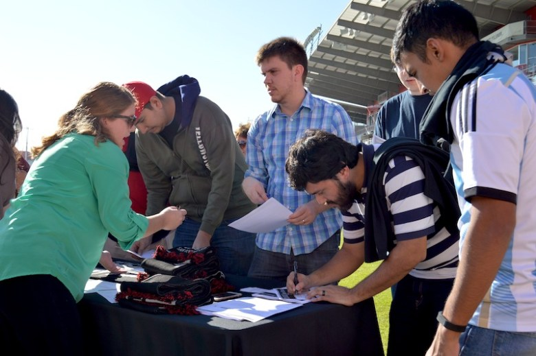 Soccer fans make deposits for USL seats at Toyota Field. Photo by Lea Thompson.
