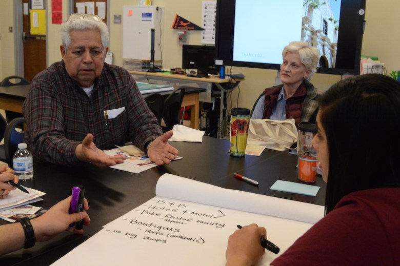 Abel Ramirez, a local who owns a bike shop near the missions, participates in a small business breakout session. Photo by Lea Thompson.