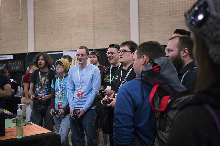 A group of gamers compete against each other to win a Chainsawesome game. Photo by Kathryn Boyd-Batstone