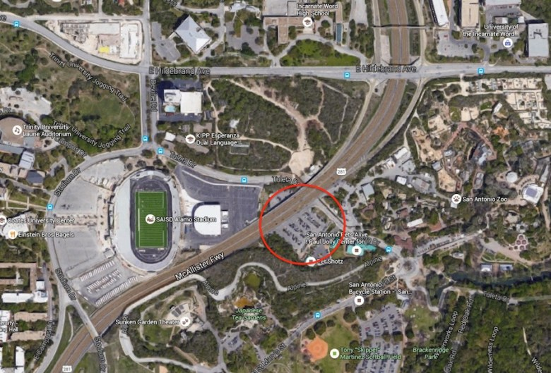 The land (parking lot) between the Alamo Stadium (right) and San Antonio Pets Alive (left) owned by SAISD on Tuleta Drive across from the San Antonio Zoo. Image via Google Maps.