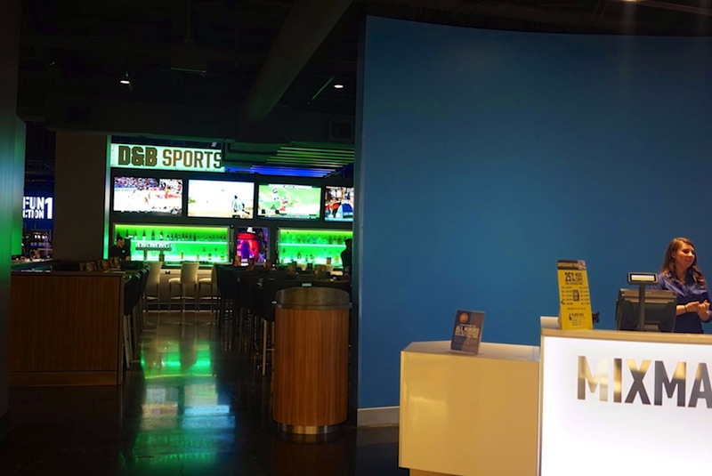 The reception desk (right) and sports bar inside the Rivercenter Mall's new Dave & Buster's. Photo by Iris Dimmick