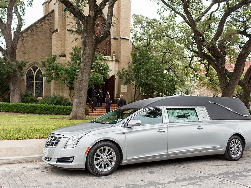 A hearse arrives at David Molak's memorial service. Photo by Rachel Chaney.