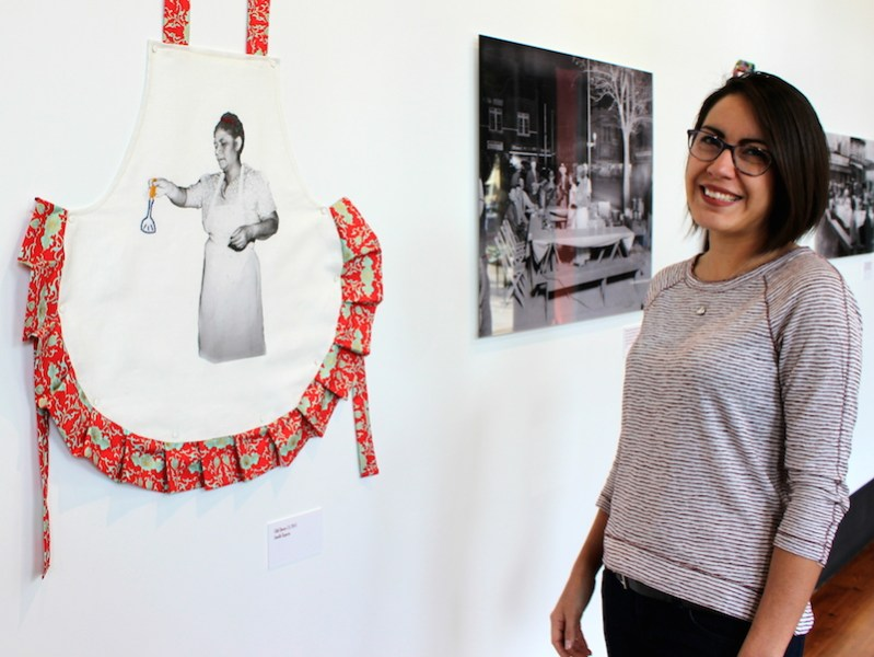"""Jenelle Esparza poses for a photo at her """"Chili Queens"""" exhibit in Plaza de Armas. Photo by Iris Gonzalez."""