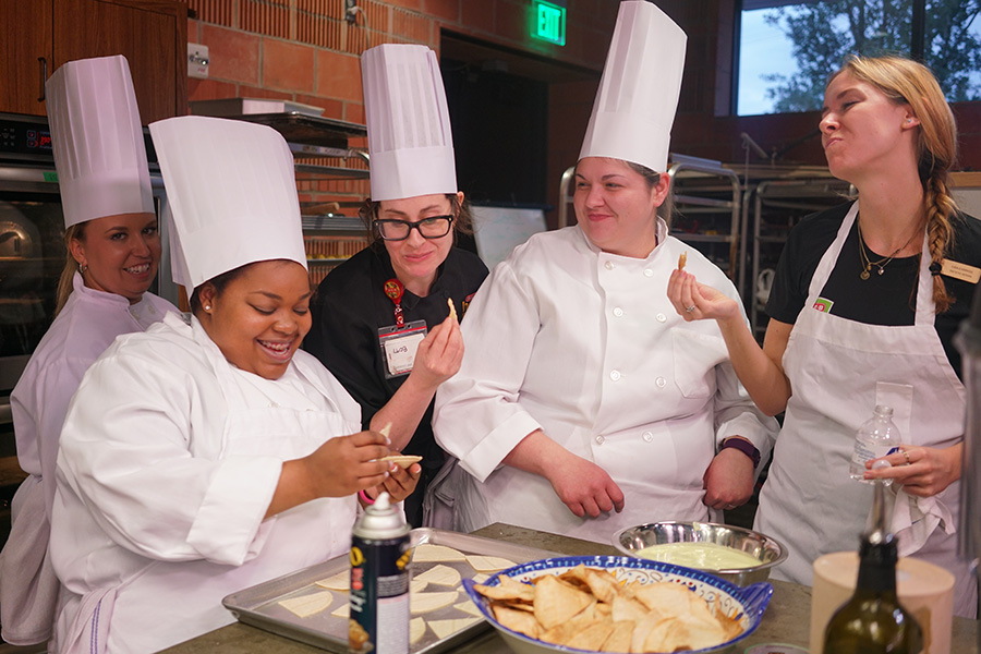 Culinary Nutritionist Charlotte Samuel reacts to trying a creamy poblano and plantains sauce. Photo by Kathryn Boyd-Batstone