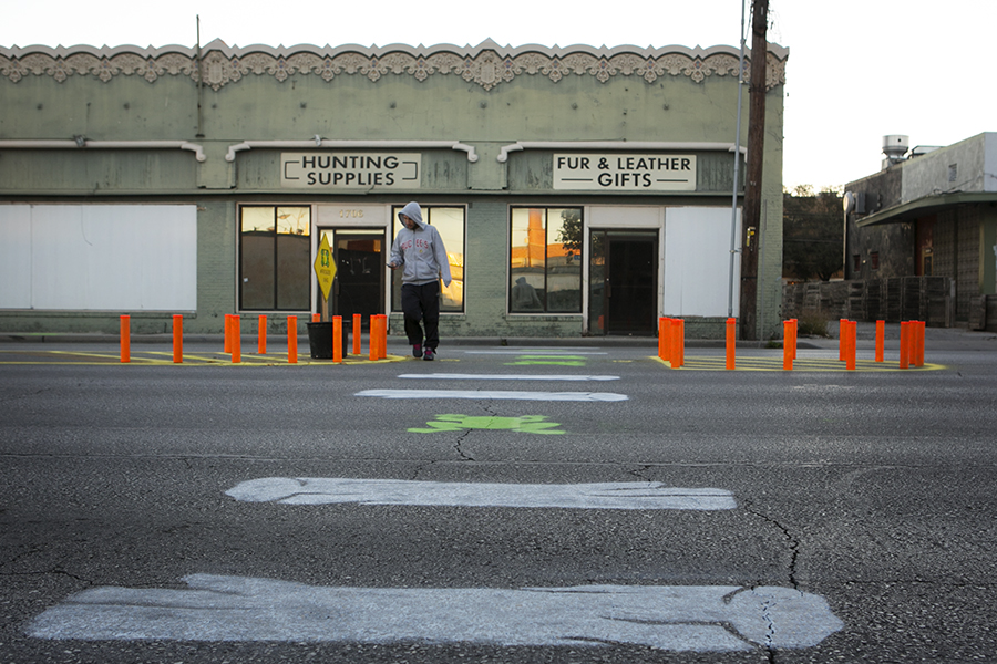 A man uses the crosswalk at the intersection of Pearl Parkway and Broadway Street to get to the Broadway Street bus stop. Photo by Kathryn Boyd-Batstone