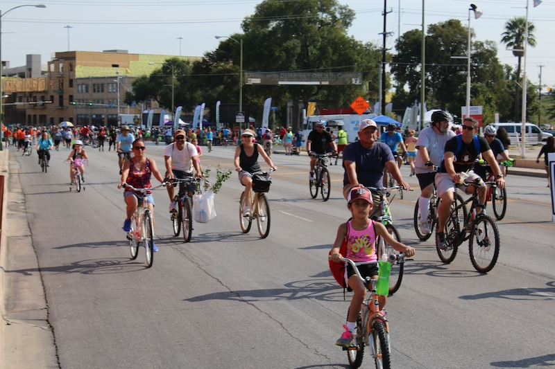 Families ride, walk and skate down Broadway St during the 9th Síclovía event on Sep. 27, 2015. Photo courtesy of YMCA of Greater San Antonio.