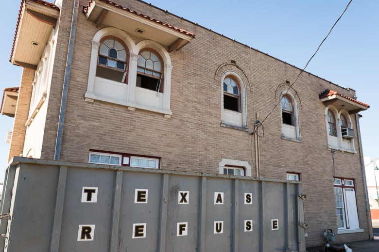 A dumpster sits outside the former Fire Station No. 7 while the building undergoes renovations. Photo by Scott Ball.