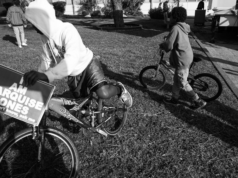 Children ride their bicycles during the opening ceremonies before the march. Photo by Scott Ball.