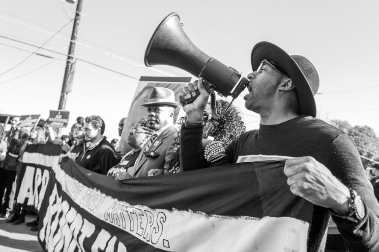 Local activist Mike Lowe calls for the imprisonment of San Antonio Police Department officer Robert Encina. Photo by Scott Ball.