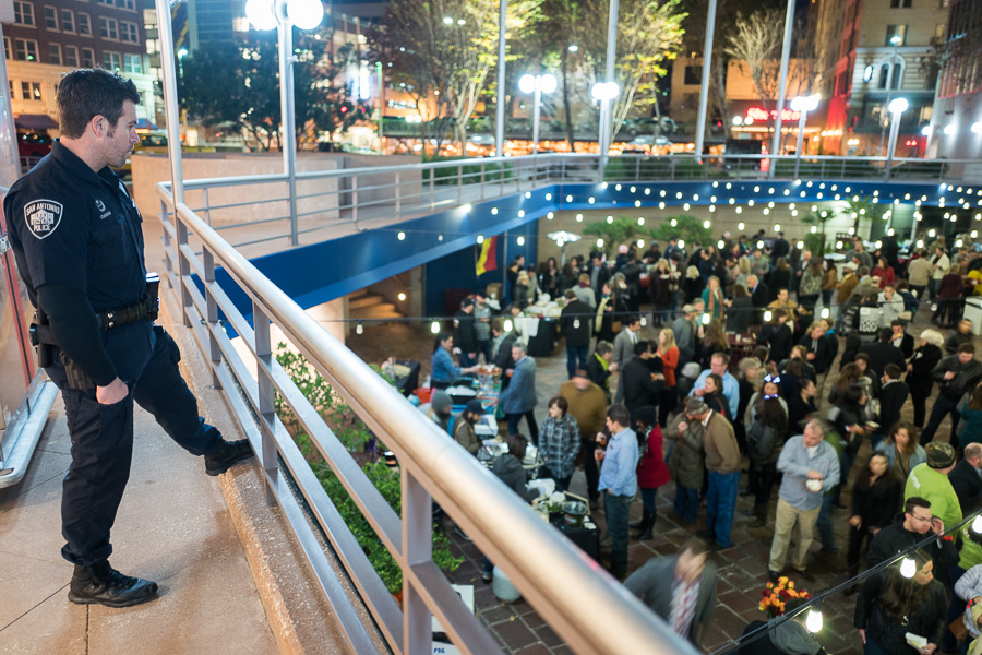 San Antonio Police Officer Cummins overlooks the crowd of SACC guests. Photo by Scott Ball.