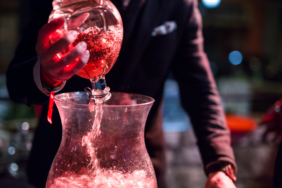 Liquor is poured into a giant punch bowl on the patio at Lüke. Photo by Scott Ball.