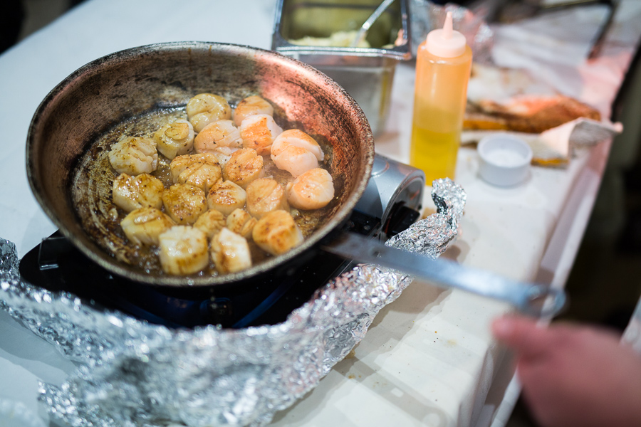 Scallops are made in front of VisionWorks by Palm Restaurant. Photo by Scott Ball.