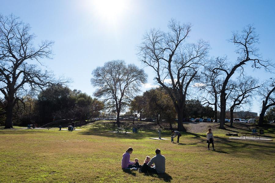 Families enjoy time in Brackenridge Park near the San Antonio Zoo. Photo by Scott Ball.